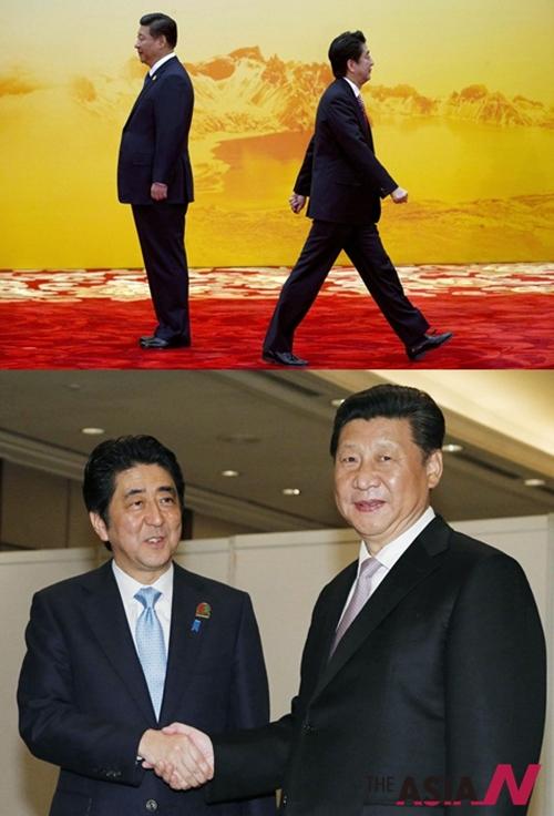 지난해 11월 중국 베이징 외곽에 있는 옌치후 국제회의센터에서 열린 아시아·태평양경제협력체(APEC) 정상회의 환영식에서 아베 신조 일본 총리(오른쪽)가 시진핑 국가주석과 등을 돌리고 있다. 이와 대조적으로 아래의 사진에선 지난 22일 시진핑(習近平) 중국 국가 주석과 아베 신조 일본 총리(왼쪽)가  인도네시아 자카르타에서 열린 아시아-아프리카 정상회의에서 양국관계 현안 등을 논의하고 있다.