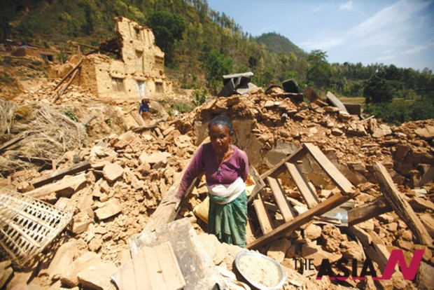 An old lady is seen in the rubble of her damaged house in this picture printed in the local Nepali Times weekly