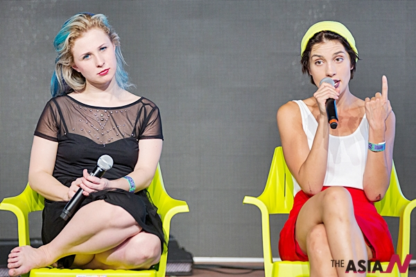 (150815) -- BUDAPEST, Aug. 15, 2015 (Xinhua) -- Russia's Maria Alyokhina (L) and Nadezhda Tolokonnikova (R), members of the Pussy Riot feminist punk rock band, talk during an interactive conversation in the Sziget Festival in Budapest, Hungary on Aug. 14, 2015. (Xinhua/Attila Volgyi)