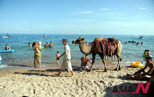 Tourists enjoy themselves at the Lake Issyk Kul in Kyrgyzstan, Aug. The Lake Issyk Kul, with a surface area of about 6,300 square kilometers, is a famous tourism destination in Kyrgyzstan.