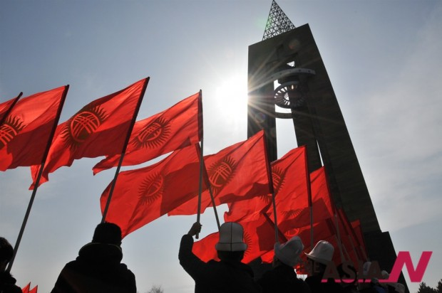 "Kyrgyz people hold national flags during a rally marking the ""National Flag Day"" in Victory Square of Kyrgyzstan's capital Bishkek on March 3, 2015."
