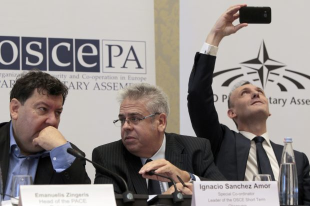 Emanuelis Zingeris, a head of the PACE Delegation, left, Ignacio Sanchez Amor, a leader of the OSCE Short Term Observers, and Guglielmo Picchi, Head of the OSCE Parliamentary Assembly Delegation, right, attend a news conference after the parliamentary election in Tbilisi, Georgia, Sunday, Oct. 9, 2016. Georgia's governing party, which has pursued both closer ties with the West and improved relations with Russia, was strongly in the lead Sunday after votes for its parliamentary election were counted from more than 80 percent of the country's precincts. (AP Photo/Shakh Aivazov)