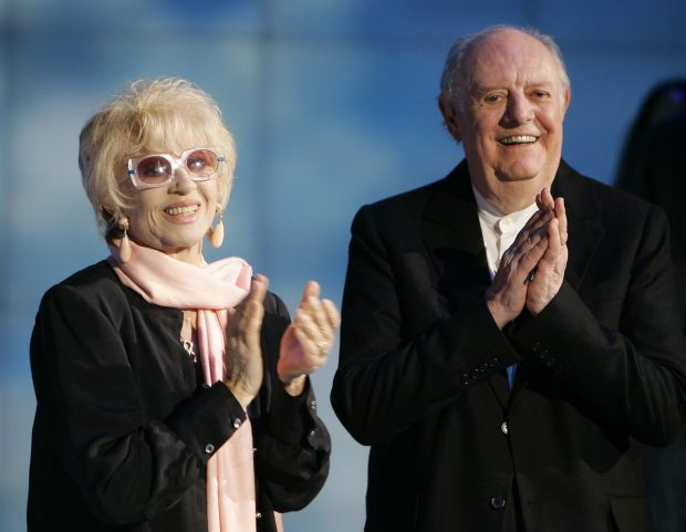 """FILE - In this May 9, 2009 file photo Italian Nobel prize winner Dario Fo, right, and his wife Franca Rame applaud during the Italian State RAI TV program """"Che Tempo che Fa"""", in Milan, Italy. According to ANSA news agency Fo died on Thursday, Oct. 13, 2016 in Milan at the age of 90. (AP Photo/Antonio Calanni, File)"""