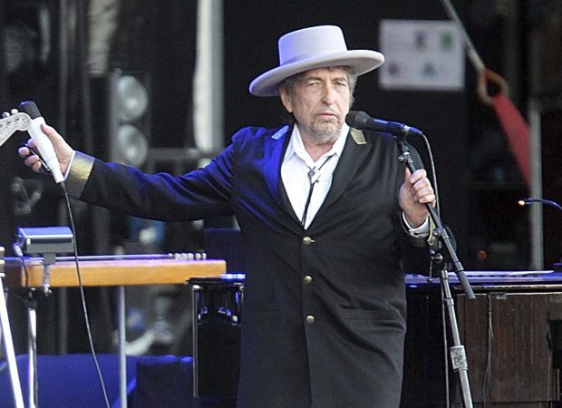 "U.S. singer-songwriter Bob Dylan performing onstage at ""Les Vieilles Charrues"" Festival in Carhaix, western France. Dylan won the 2016 Nobel Prize in literature, announced Thursday, Oct. 13, 2016. (AP Photo/David Vincent, File)"