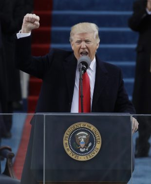 President Donald Trump pumps his fist after delivering his inaugural address after being sworn in as the 45th president of the United States during the 58th Presidential Inauguration at the U.S. Capitol in Washington, Friday, Jan. 20, 2017. (AP Photo/Patrick Semansky)