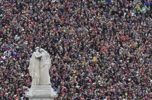 People listen during the inaugural address by President Donald Trump during the Inauguration on Capitol Hill in Washington, Friday, Jan. 20, 2017. (Ricky Carioti/The Washington Photo/Pool Photo via AP)